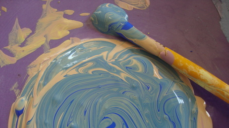 Mixing paints can create beautiful new intersections of color.